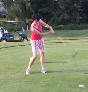 Lynnette golfing